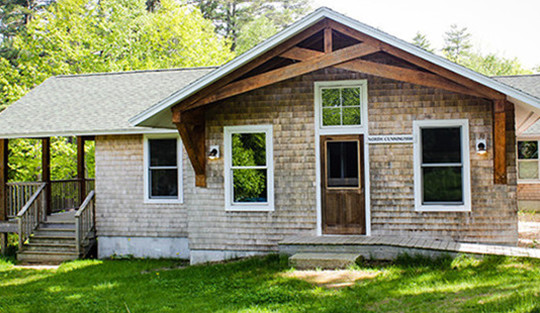 cabin-exterior-camp-kieve-great-mother-new-father-conference